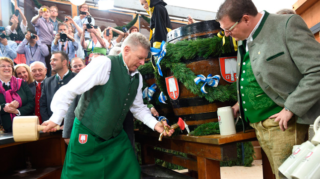 The mayor of Munich, Germany taps the first keg at Munich's famous Oktoberfest.